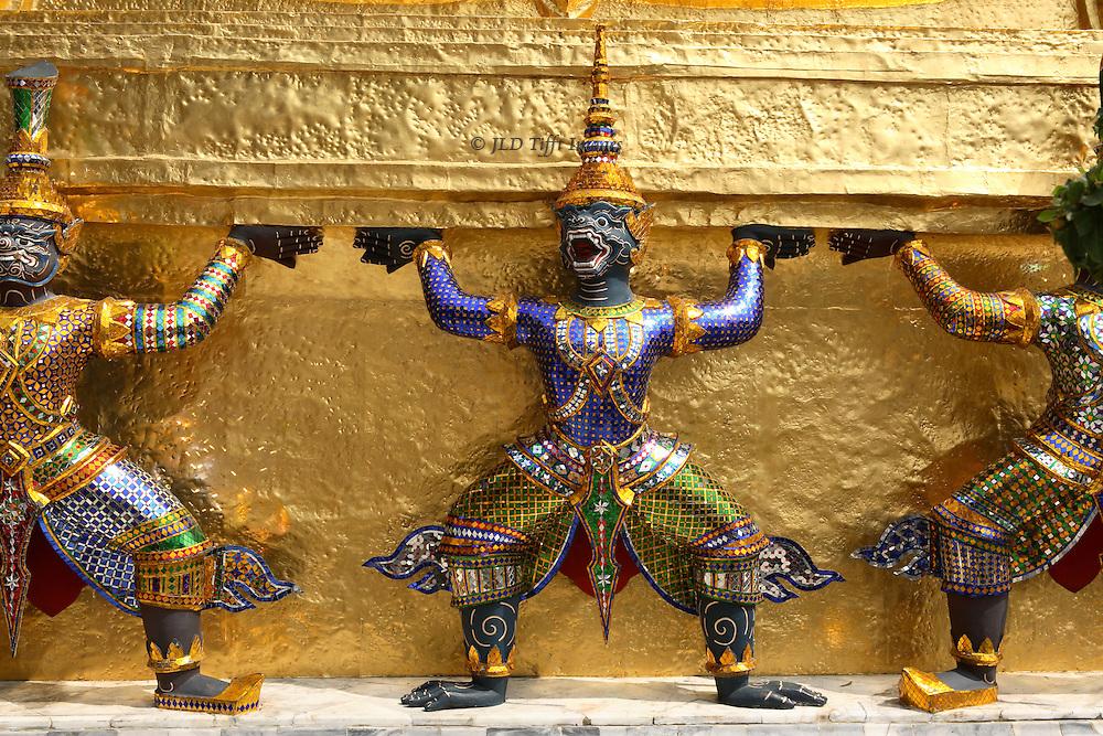 Detail of gold and enamel caryatid figures on the royal palace, Bangkok