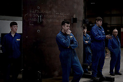 "© London News Pictures. ""Looking for Nigel"". A body of work by photographer Mary Turner, studying UKIP leader Nigel Farage and his followers throughout the 2015 election campaign. PICTURE SHOWS - Metal workers at Concept Metals in Heywood & Middleton listen to Nigel Farage speaking about the country's economy, on March 23rd 2015. Mr Farage capitalised on the feelings of alienation that many working class and more 'blue collar' workers felt, trying to appeal to their sense of alienation during his election campaign. . Photo credit: Mary Turner/LNP **PLEASE CALL TO ARRANGE FEE** **More images available on request**"