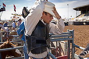 November 2, 2008 -- PHOENIX, AZ: TREVOR HAUGHT, from Payson, AZ, prepares to ride in the saddle bronc riding at the Arizona High School Rodeo at the Arizona State Fair in Phoenix. Teams from across the state participate. The Arizona High School Rodeo Association sponsors a full season of high school rodeo that culminate in a championship rodeo in June.  Photo by Jack Kurtz / ZUMA Press