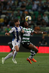April 18, 2018 - Lisbon, Portugal - Sporting's forward Gelson Martins from Portugal (R ) vies with Porto's Spanish midfielder Oliver Torres during the Portugal Cup semifinal second leg football match Sporting CP vs FC Porto at the Alvalade stadium in Lisbon on April 18, 2018. (Credit Image: © Pedro Fiuza/NurPhoto via ZUMA Press)
