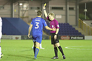 AFC Wimbledon defender Jon Meades (3) yellow card during the EFL Trophy match between AFC Wimbledon and Luton Town at the Cherry Red Records Stadium, Kingston, England on 31 October 2017. Photo by Matthew Redman.