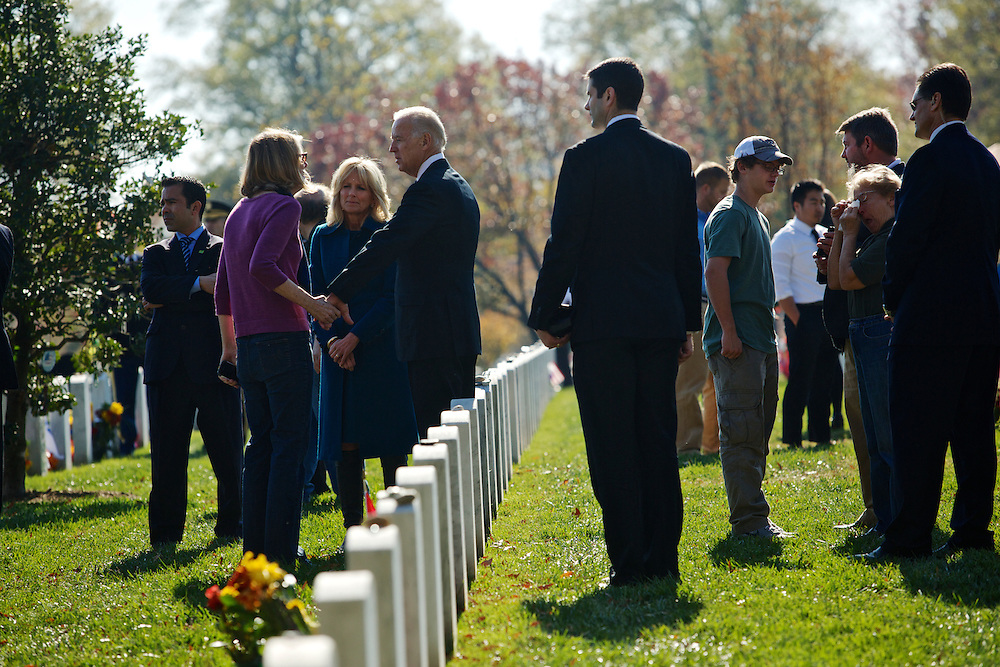 ARLINGTON, VA - NOVEMBER 11: U.S. Vice President Joe Biden and his wife, Dr. Jill Biden, greet family members of fallen service men and women on Veteran's Day at Arlington National Cemetery on November 11, 2012 in Arlington, Virginia.