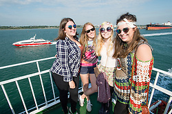 © Licensed to London News Pictures. 11/06/2015. East Cowes, UK.  Festival goers wearing hippy seventies dress travelling to Isle of Wight Festival 2015 on the Southampton-East Cowes ferry early on thursday morning.  This years festival include headline artists the Prodigy, Blur and Fleetwood Mac.  Photo credit : Richard Isaac/LNP
