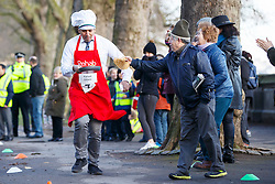 © Licensed to London News Pictures. 28/02/2017. London, UK. Sky News' FASIAL ISLAM races against MPs and Lords at the annual Rehab Parliamentary Pancake Race outside the Parliament on Shrove Tuesday, 28 February 2017. Photo credit: Tolga Akmen/LNP