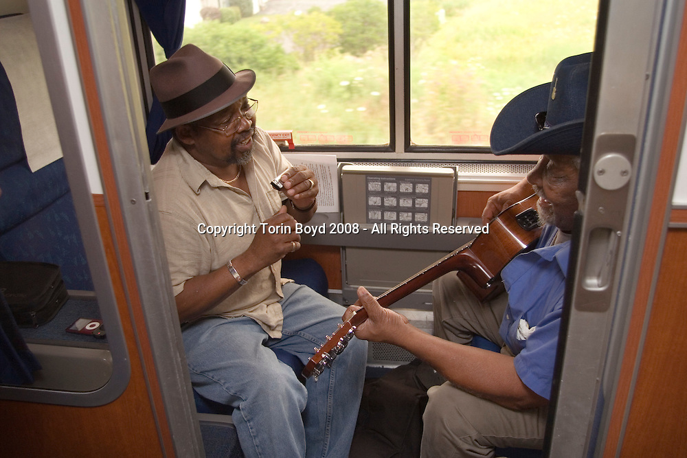 Outside  Milwaukee, Wisconsin: Jay Summerhour and Warner Williams get in some music during their train journey from Washington DC to Washington State.