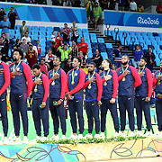 Basketball - Olympics: Day 16  The united States team during the National Anthem after receiving their gold medals, from left, Jimmy Butler, Kevin Durant, DeAndre Jordan, Kyle Lowry, Harrison Barnes, Demar DeRozan, Kyrie Irving, Klay Thompson, Demarcus Cousins, Paul George, Draymond Green, Carmelo Anthony after the USA Vs Serbia Men's Basketball Gold Medal game at Carioca Arena1on August 21, 2016 in Rio de Janeiro, Brazil. (Photo by Tim Clayton/Corbis via Getty Images)