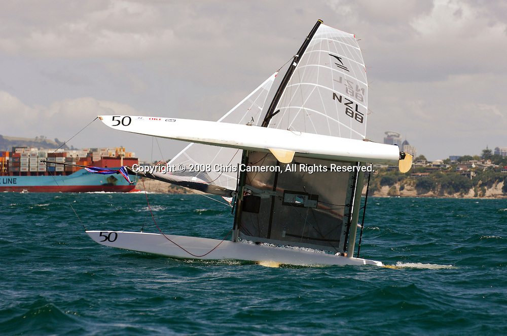 New Zealand team of William Caunce and Andrew Springford (NZL88) takes a spill after losing a sailor overboard at the top mark in race seven of the 2008 World Tornado Championships. Takapuna Auckland New Zealand. 29/2/2008