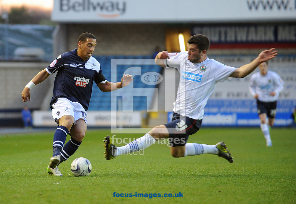 Picture by Seb Daly/Focus Images Ltd +447738 614630.23/04/2013.Liam Feeney of Millwall is fouled by Grant Hanley of Blackburn Rovers during the npower Championship match at The Den, London.