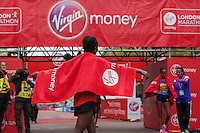 Tigist Tufa of Ethiopia immediately after crossing the line to win the Elite Womens race in The Virgin Money London Marathon, Sunday 26th April 2015.<br /> <br /> Scott Heavey for Virgin Money London Marathon<br /> <br /> For more information please contact Penny Dain at pennyd@london-marathon.co.uk