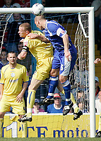 Photo: Mike Greenslade..Cardiff City v Sheffield Wednesday..Coca Cola Championship League..07.04.07..Ninian Park..KO 3pm...Owls defender Lee Bullen clears a corner while under pressure form Cardiff's Darren Purse