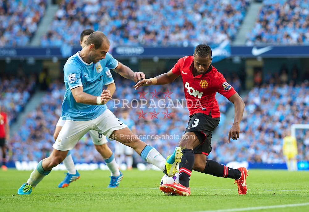 MANCHESTER, ENGLAND - Sunday, September 22, 2013: Manchester United's Patrice Evra in action against Manchester City during the Premiership match at the City of Manchester Stadium. (Pic by David Rawcliffe/Propaganda)