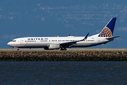 Boeing 737-924(ER) (N69818) operated by United Airlines landing at San Francisco International Airport (KSFO), San Francisco, California, United States of America