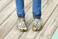 dirty, muddy, feet, crocs, jeans, explore, kid, children, child's, age, 10, 11, 12, mess, messy, slimy, blue, boardwalk, standing, close, up, detailed, detail, dirt, mud, sloppy, slop, muck, legs, shoes, soiled, you, young, water, wet, sandals, little