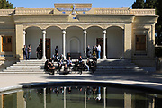 Ateshkadeh. Often referred to as the Zoroastrian Fire Temple, this elegant neoclassical building, reflected in an oval pool in the garden courtyard, houses a flame that is said to have been burning since about AD 470. Visible through a window from the entrance hall, the flame was transferred to Ardakan in 1174, to Yazd in 1474 and to its present site in 1940. It is cherished (not worshipped) by the followers of the Zoroastrian faith – the oldest of the world's monotheistic religions.