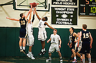 Rice's Ben Shungu (11) and Essex's Aidan Travers (32) battle for the rebound during the boys basketball game between the Essex Hornets and the Rice Green Knights at Rice Memorial high school on Tuesday night December 22, 2015 in South Burlington.(BRIAN JENKINS/for the FREE PRESS)