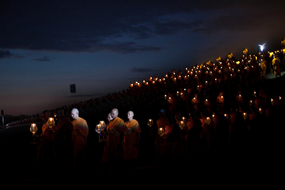 Monks of the Dhammakaya Buddhist movement founded in Thailand are seen during Makha Bucha day at Wat Phra Dhammakaya  on the outskirts of Bangkok, Thailand Wednesday, March 7, 2012.
