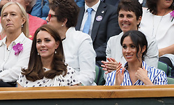 LONDON, ENGLAND - Saturday, July 14, 2018: Royal WAGS Catherine Middleton (Duchess of Cambridge married to William Windor) (left) and Rachel Meghan Markle (Duchess of Sussex married to Harry Windsor) (right) in the Royal Box during the Gentlemen's Singles Semi-Final match on day twelve of the Wimbledon Lawn Tennis Championships at the All England Lawn Tennis and Croquet Club. (Pic by Kirsten Holst/Propaganda)
