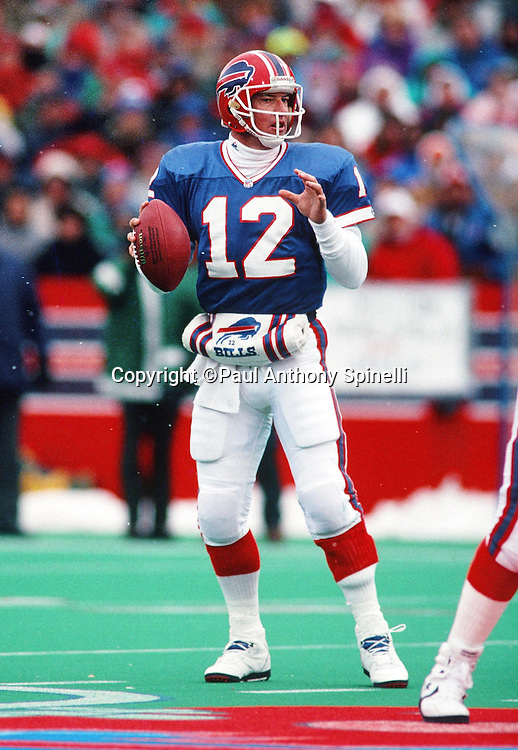 Buffalo Bills quarterback Jim Kelly (12) drops back to pass during the NFL football game against the New England Patriots on Nov. 3, 1991 in Orchard Park, N.Y. The Bills won the game 22-17. (©Paul Anthony Spinelli)
