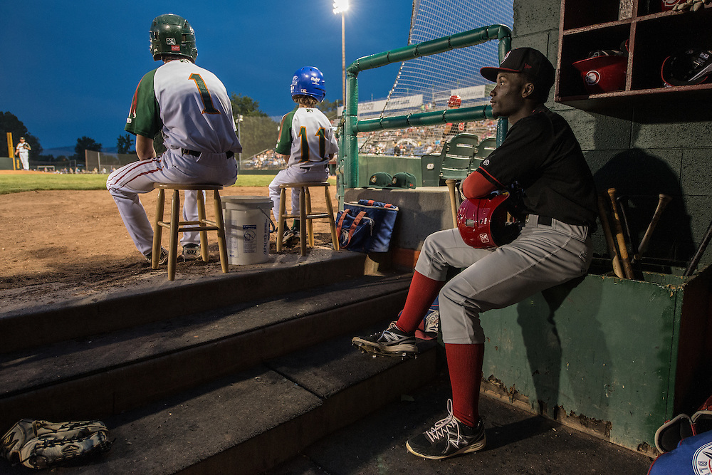 The Vancouver Canadians Roemon Fields sits in the dugout before his at-bat vs. the Boise Hawks in Boise, Idaho.