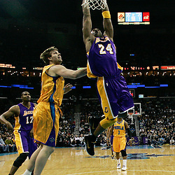 February 5, 2011; New Orleans, LA, USA; Los Angeles Lakers shooting guard Kobe Bryant (24) dunks over New Orleans Hornets center Aaron Gray (34) during a game at the New Orleans Arena. The Lakers defeated the Hornets 101-95.  Mandatory Credit: Derick E. Hingle