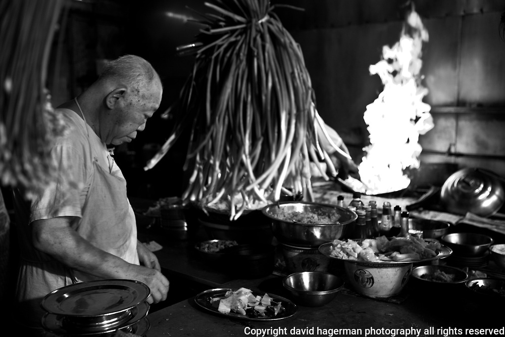 Cooking in a traditional Chinese kitchen in Kuala Lumpur, Malaysia