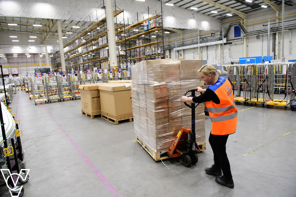 Stock / generic photographs taken at the Royal Mail's Yorkshire Distribution Centre, Normanton.  <br /> <br /> Emma Smith moving a pallet of parcels<br /> <br /> Picture: Chris Vaughan Photography<br /> Date: November 15, 2016