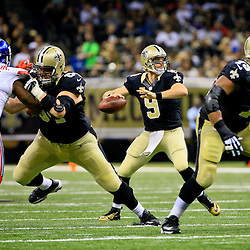 Nov 1, 2015; New Orleans, LA, USA; New Orleans Saints quarterback Drew Brees (9) looks to pass against the New York Giants during the second quarter of a game at the Mercedes-Benz Superdome. Mandatory Credit: Derick E. Hingle-USA TODAY Sports