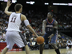 Apr 11; Newark, NJ, USA; Charlotte Bobcats center Kwame Brown (54) passes the ball while being defended by New Jersey Nets center Brook Lopez (11) during the second half at the Prudential Center. The Bobcats defeated the Nets 105-103.