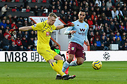 Aaron Ramsdale (12) of AFC Bournemouth clears the ball was Anwar El Ghazi (21) of Aston Villa closes in during the Premier League match between Bournemouth and Aston Villa at the Vitality Stadium, Bournemouth, England on 1 February 2020.