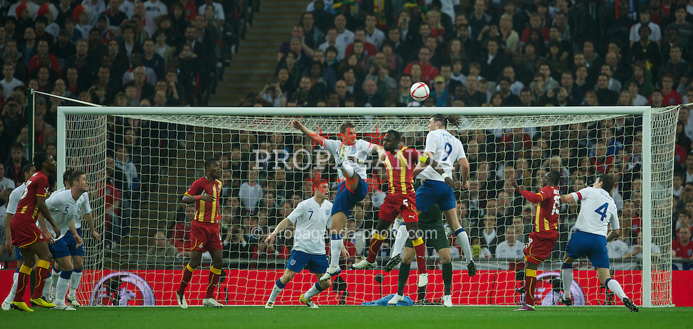 LONDON, ENGLAND - Tuesday, March 29, 2011: England's Phil Jagielka and Andy Carroll in action against Ghana's captain John Mensah during the international friendly match at Wembley Stadium. (Photo by David Rawcliffe/Propaganda)