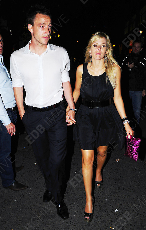 30.MAY.2009 - LONDON<br /> <br /> JOHN TERRY AND WIFE TONI POOLE LEAVING MOVIDA NIGHT CLUB AT 4.00AM.<br /> <br /> BYLINE MUST READ : EDBIMAGEARCHIVE.COM<br /> <br /> *THIS IMAGE IS STRICTLY FOR UK NEWSPAPERS &amp; MAGAZINES ONLY* <br /> *FOR WORLDWIDE SALES OR WEB USE PLEASE CONTACT EDBIMAGEARCHIVE - 0208 954-5968*
