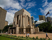 "ANZAC War Memorial, Sydney, Australia. Finished in 1934 after designs and art by C. Bruce Dellit and sculptor Rayner Hoff, it commemorates the Australian War dead of World War One. ..Many of the original sculptures didn't make it in the memorial, thanks to censure by the Catholic church, and its bishop, Michael Sheehan. .. The sculpture that caused the sensation, The Crucifixion of Civilisation, is pictured below. It is shocking. A naked figure on a cross, a young woman, sits atop a pyramid of broken soldiers, corpses, weapons, helmets, the debris of battle. The detail is hyper-real and brilliantly executed. Hoff described the symbolism of his central figure: ""Adolescent Peace is depicted crucified on the armaments of the ravisher, the war god, Mars. The Greek helmet animalistically gapes over the head of expiring Peace, the cuirass of the body armour hard and brutal in contrast to her lithe woman's body.""..Lithe women's bodies have always caused problems for the Catholic Church, and Hoff's depictions of the human body were intrinsically sensual. (His famous 1924 sculpture, Faun and Nymph, part of the collection of the Art Gallery of NSW, is basically pornographic.) This particular lithe naked woman was especially problematic...The Catholic archbishop of Sydney, Michael Sheehan, announced that he would not be attending the laying of the foundation stone on July 19, 1932. The memorial, he said, was ""obviously intended only for Protestants"". As for the young woman on the cross, this image was ""gravely offensive to ordinary Christian decency""..http://www.smh.com.au/articles/2004/04/18/1082226632478.html?from=storyrhs."