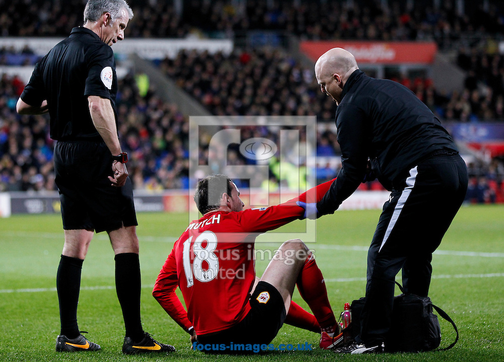 Jordan Mutch of Cardiff City leaves the pitch against Aston Villa with an injury during the Barclays Premier League match at the Cardiff City Stadium, Cardiff<br /> Picture by Mike  Griffiths/Focus Images Ltd +44 7766 223933<br /> 11/02/2014