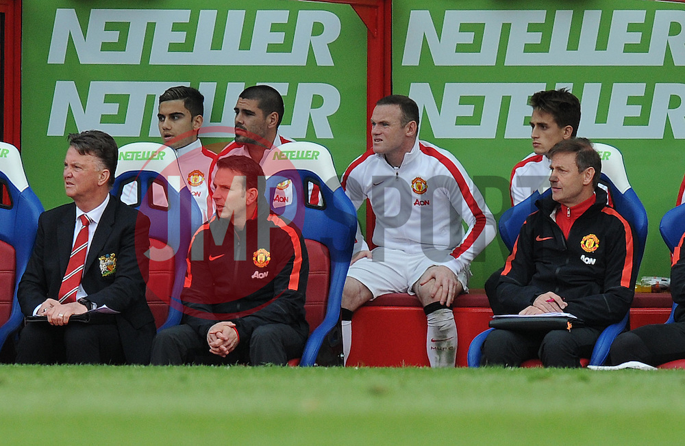 Manchester United's Wayne Rooney watches from the bench during the second half after injuring his thigh. - Photo mandatory by-line: Alex James/JMP - Mobile: 07966 386802 - 09/05/2015 - SPORT - Football - London - Selhurst Park - Crystal Palace v Manchester United - Barclays Premier League
