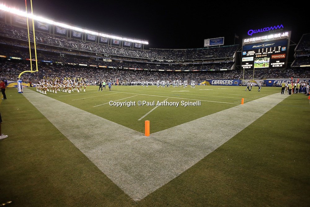 Both teams await the end of a time out as the San Diego Chargers cheerleaders cheer during the two minute warning near the end of the fourth quarter during the 2015 NFL preseason football game against the Dallas Cowboys in this general view photograph taken on Thursday, Aug. 13, 2015 in San Diego. The Chargers won the game 17-7. (©Paul Anthony Spinelli)