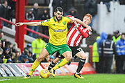 Norwich City Forward Nélson Oliveira (9) holds off Brentford Midfielder Ryan Woods (15) during the EFL Sky Bet Championship match between Brentford and Norwich City at Griffin Park, London, England on 27 January 2018. Photo by Stephen Wright.
