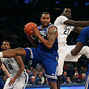 Eugene Teague, Seton Hall, rebounds during the Villanova Wildcats Vs Seton Hall Pirates basketball game during the Big East Conference Tournament at Madison Square Garden, New York, USA. 12th March 2014. Photo Tim Clayton