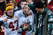 LANDOVER, MD - NOVEMBER 11: A Philadelphia Eagle's fan catches a ball in the stands  during the game against the Washington Redskins on November 11, 2007 at FedEx Field in Landover, Maryland. The Eagles won 33-25.