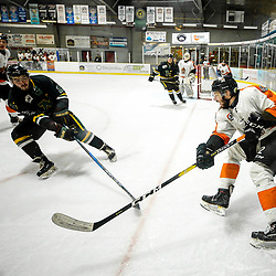 COCHRANE, ON - MAY 1: Daniel Fisher #12 of the Hearst Lumberjacks passes the puck on May 1, 2019 at Tim Horton Events Centre in Cochrane, Ontario, Canada.<br /> (Photo by Christian Bender / OJHL Images)
