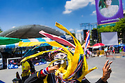 15 MAY 2014 - BANGKOK, THAILAND:  A People's Democratic Reform Committee supporter wearing a Guy Fawkes mask dances at the PDRC protest site on Phan Fa Bridge in Bangkok. The PDRC has stages and camps set up along Ratchadamnoen Ave from Democracy Monument to Government House.      PHOTO BY JACK KURTZ