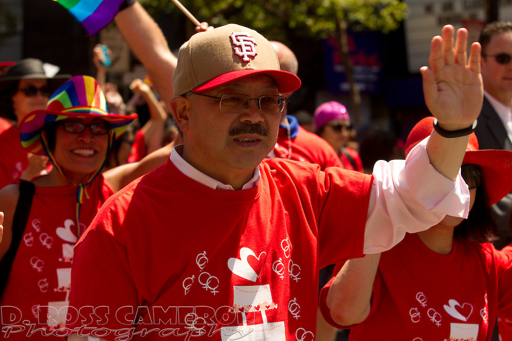 San Francisco Mayor Ed Lee, center, was among the marchers at the 43rd annual San Francisco Pride parade, Sunday, June 30, 2013 in San Francisco. (Photo by D. Ross Cameron)