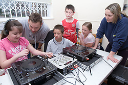 Children learning to use a turntable at Greenlane Youth Centre; Nottingham,