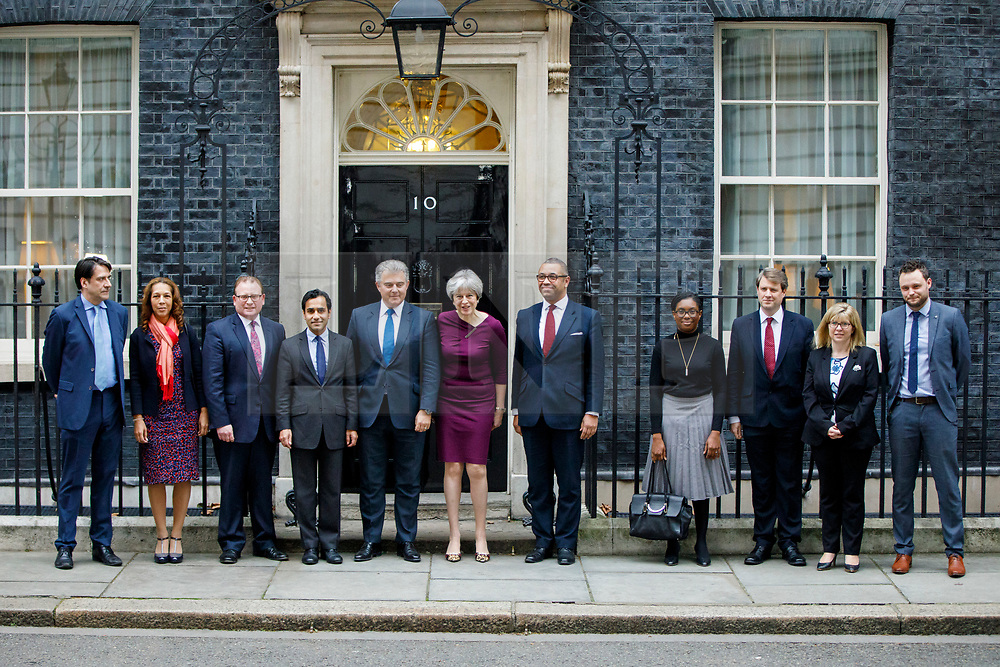 © Licensed to London News Pictures. FILE PIC 08/01/2018. London, UK. Prime Minister Theresa May poses Ben Bradley and Maria Caulfield (far right) on Downing Street following a cabinet reshuffle on Monday, 8 January 2018. Conservative party vice-chairs Ben Bradley and Maria Caulfield resigned form their positions yesterday over Theresa May's Brexit proposals. Photo credit: Tolga Akmen/LNP
