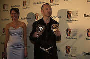 Graham Norton and Claire Sweeney. BAFTA Television Awards, sponsored by the Radio Times, Grosvenor House. London. 13 May 2001. © Copyright Photograph by Dafydd Jones 66 Stockwell Park Rd. London SW9 0DA Tel 020 7733 0108 www.dafjones.com