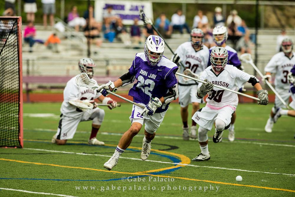 John Jay Varsity Lacrosse game at Harrison High School on May 16, 2015. (photo by Gabe Palacio)