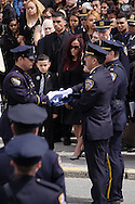 Police fill the streets of Rockaway at the funeral of NYPD PO Dennis Guerra