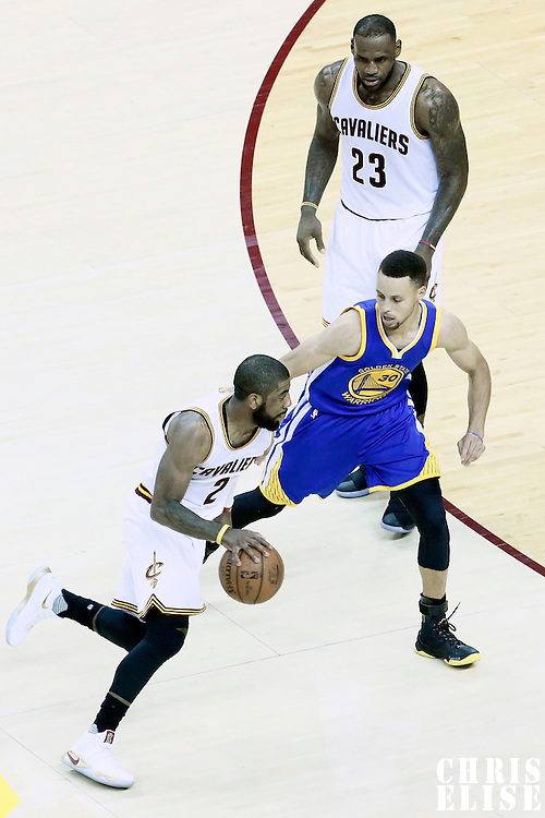 08 June 2016: Cleveland Cavaliers guard Kyrie Irving (2) drives past Golden State Warriors guard Stephen Curry (30) next to Cleveland Cavaliers forward LeBron James (23) during the Cleveland Cavaliers 120-90 victory over the Golden State Warriors, during Game Three of the 2016 NBA Finals at the Quicken Loans Arena, Cleveland, Ohio, USA.