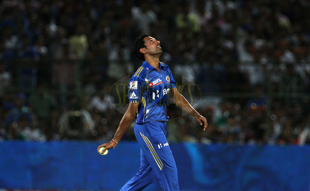 Mumbai Indian player Dhawal Kulkarni looks up in the air after taking a catch during match 72 of the Indian Premier League ( IPL) 2012  between The Rajasthan Royals and the Mumbai Indians  held at the Sawai Mansingh Stadium in Jaipur on the 20th May2012..Photo by Vipin Pawar/IPL/SPORTZPICS