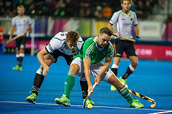 Ireland's Alan Sothern is tackled by Constantin Staib of Germany. Ireland v Germany - Unibet EuroHockey Championships, Lee Valley Hockey & Tennis Centre, London, UK on 23 August 2015. Photo: Simon Parker