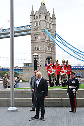 Boris Johnson at City Hall Flag Raising Ceremony.<br /> Mayor of London joins members of the London Assembly, the Royal Navy, Army and Royal Air Force to honour the bravery and commitment of the Armed Forces, with the raising of the Armed Forces Day (June 29) flag outside City Hall,<br /> London, United Kingdom<br /> Monday, 24th June 2013<br /> Picture by Nils Jorgensen / i-Images